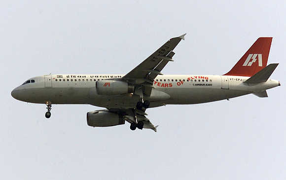 An Indian Airlines Airbus A320 flies over New Delhi.