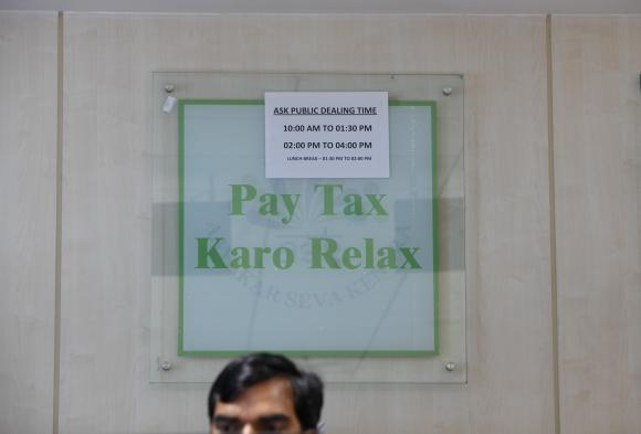 An employee works inside Income Tax office in New Delhi.