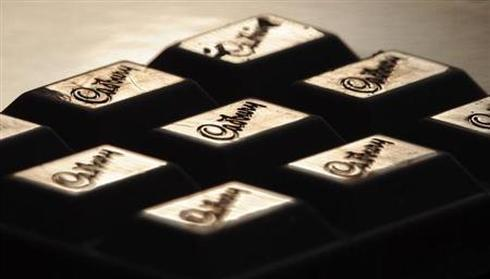 The Cadburys logo is seen on a bar of chocolate.