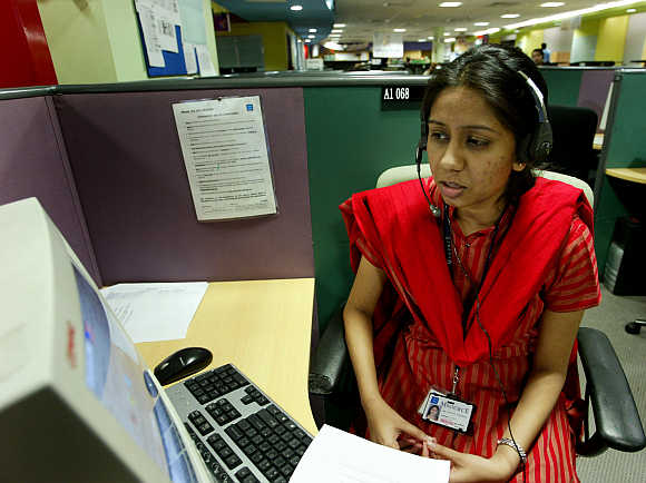 Some companies throw common-sense service norms out of the window. A call centre in Bangalore.
