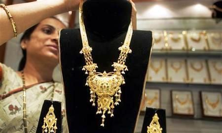 A worker displays gold jewellery at a shop in Mumbai.