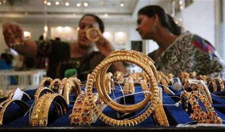 Customers look at gold bangles inside a jewellery shop in Hyderabad.