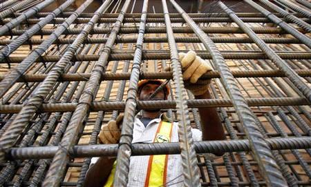 A Delhi Metro Rail Corporation employee works at the final tunnelling breakthrough of Qutub Minar and Saket stations in New Delhi.
