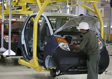 An employee works inside a plant for the Tata Nano car at Sanand.