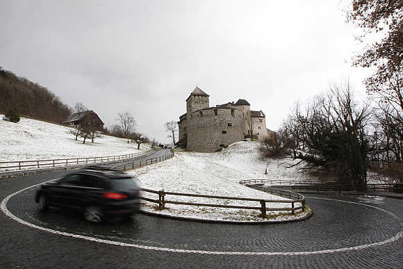 A car makes its way past Liechtenstein's castle in Vaduz.