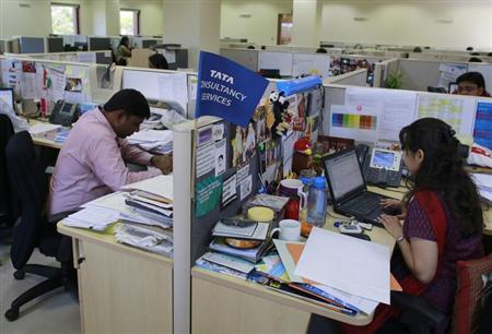 Employees of TCS work inside the company headquarters in Mumbai.