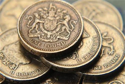 A pile of one pound coins.