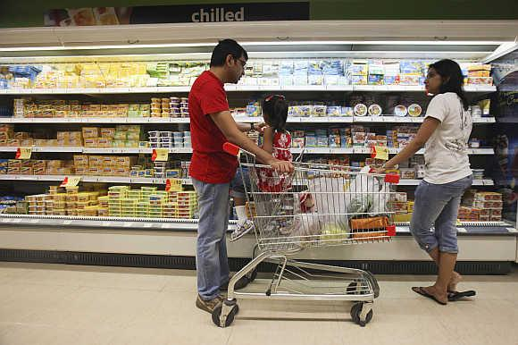 Customers shop in the chilled foods section of a Reliance Fresh supermarket in Mumbai.