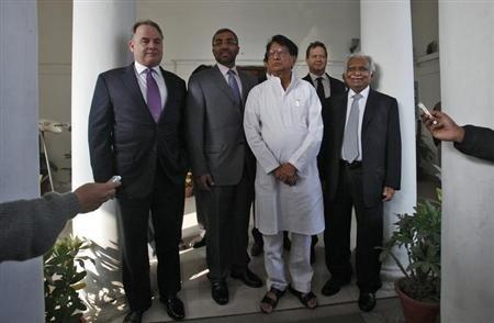 James Hogan (L), chief executive of Abu Dhabi's Etihad Airways, Ahmad Ali-al-Sayegh (2nd L), a board member of Etihad Airways, India's Civil Aviation Minister Ajit Singh (C) and Naresh Goyal (R), Chairman of Jet Airways.