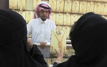 Women look at jewellery at the gold market in Riyadh.