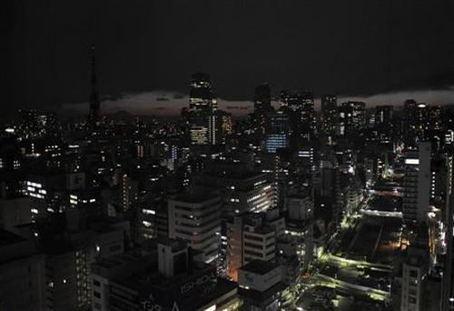 Lights are turned off to save energy before rolling blackouts in Tokyo.