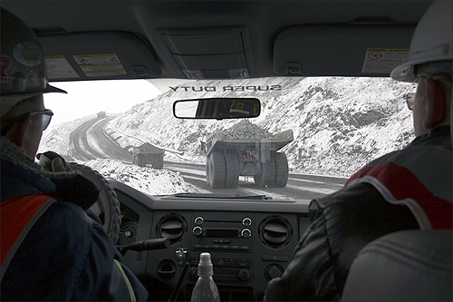 Dump trucks are seen through a windshield of another vehicle at Kumtor open pit gold mine in the Tien Shan mountains, some 350 kilometres (218 miles) southeast of the capital Bishkek near the Chinese border.