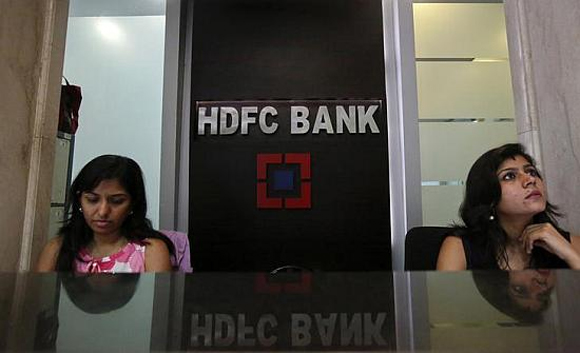 Personal bankers wait for customers at the reception of a HDFC Bank branch.