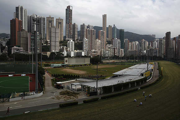 Luxurious residential blocks are seen behind Happy Valley horse racing track in Hong Kong.