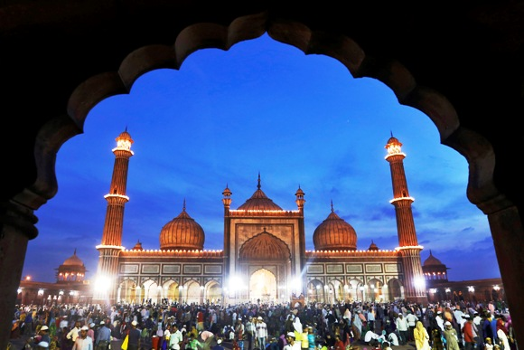 Muslims gather after having their iftar (breaking fast) meal during the holy month of Ramadan at the Jama Masjid (Grand Mosque) in the old quarters of Delhi.