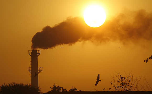 Smoke rises from a chimney of a garbage processing plant on the outskirts of Chandigarh.