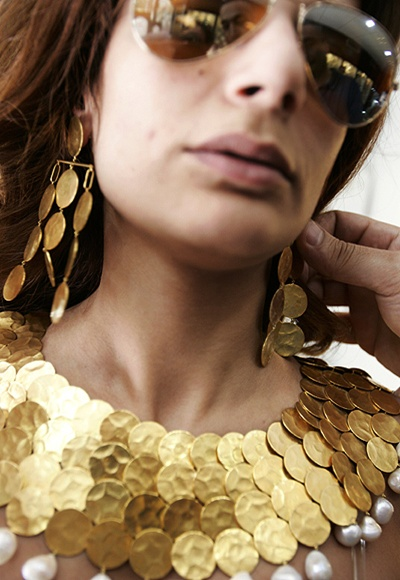 A customer wears a jewellery set at a jewellery shop in a shopping district in Beirut