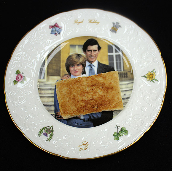 A slice of toast is seen on a plate commemorating the Royal Wedding of Britain's Prince Charles and Princess Diana, before its auction in Etwall, Derbyshire.