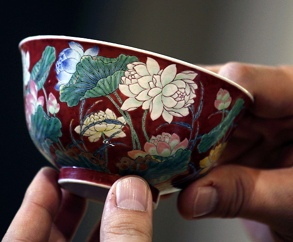 A magnificent Ruby-Ground Falangcai Double-Lotus Bowl Blue Enamel Yuzhi Mark and Period of Kangxi is shown after Hong Kong Chinese ceramics dealer William Chak has bought it for HK$74 million ($9.5 million) at Sotheby's Spring Sales in Hong Kong.