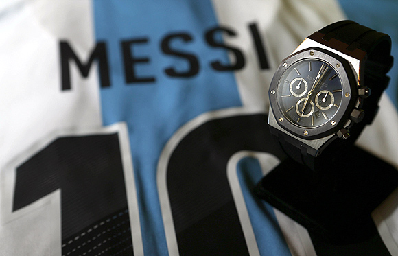 The no 10 Royal Oak Chronograph Leo Messi by Audermas Piguet is pictured on a signed Argentinean national soccer team jersey during an auction preview at Sotheby's in Geneva.