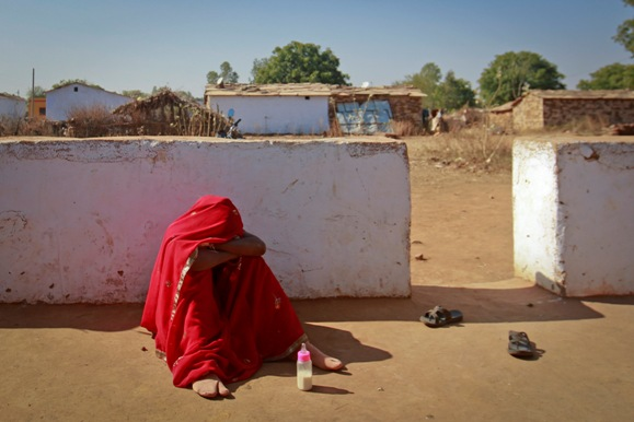 Krishna, 14, breaks down after her husband Kishan Gopal, 16, came home drunk in a village near Baran, located in Rajasthan.