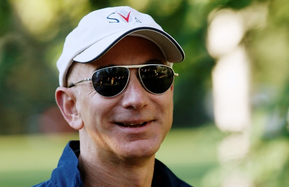 Amazon CEO Jeff Bezos (R) arrives at the annual Allen and Co. conference at the Sun Valley, Idaho Resort.
