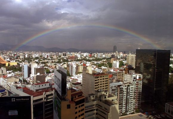 Mexico City crowned by a rainbow.