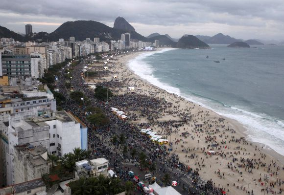 An aerial view of people flocking to see Pope Francis as he arrives at Copacabana Beach in Rio de Janeiro.
