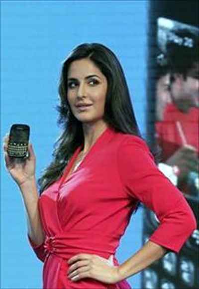 Bollywood actress Katrina Kaif poses with the BlackBerry Curve 9220 smartphone.