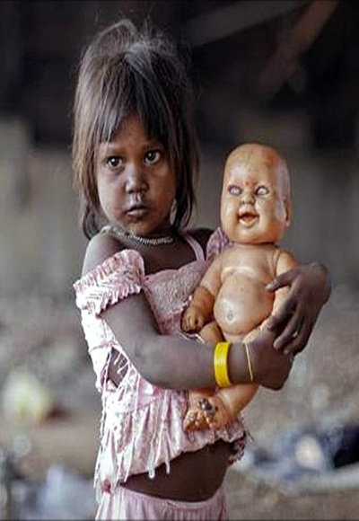 A homeless girl plays with her doll under a bridge in Mumbai.