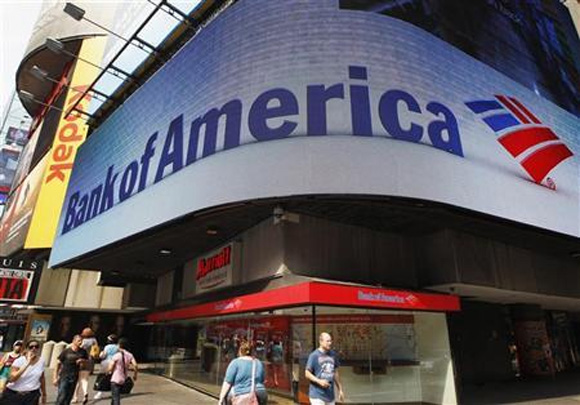 Tourists walk past a Bank of America banking center in Times Square in New York.