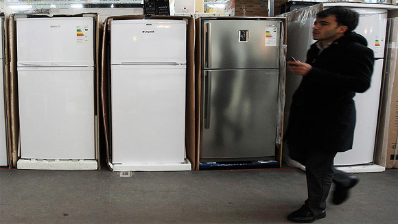 A man walks past refrigerators on sale at a store in Istanbul.