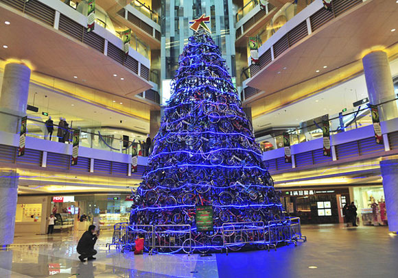 A novelty Christmas tree made of bicycles stands in a shopping mall in Shenyang, China
