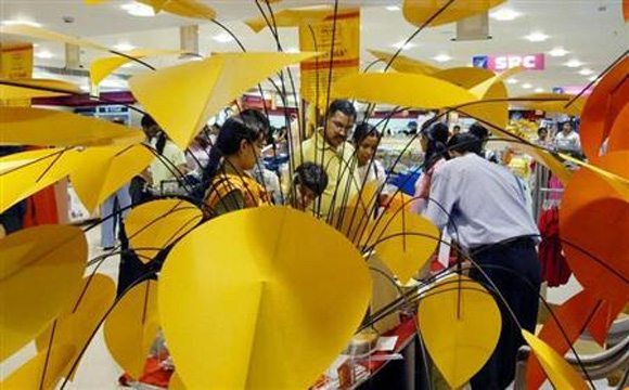 Shoppers check out products at a shopping mall in Noida.