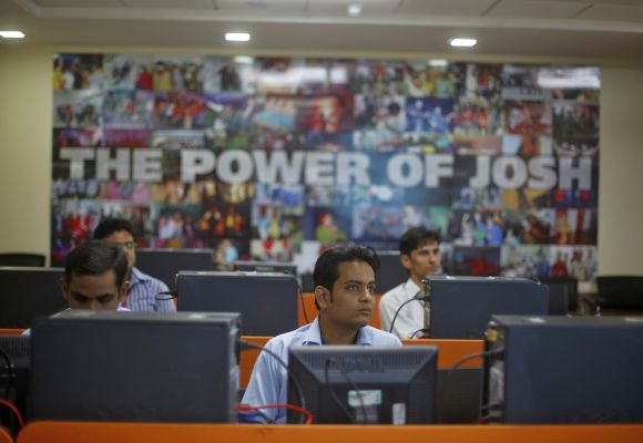 Newly recruited employees attend a training session inside Tech Mahindra office building in Noida.