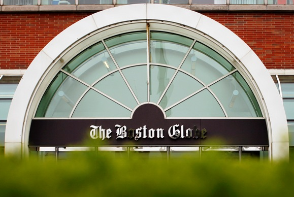 The Boston Globe's logo is seen at the entrance of the newspaper's building in Boston, Massachusetts.