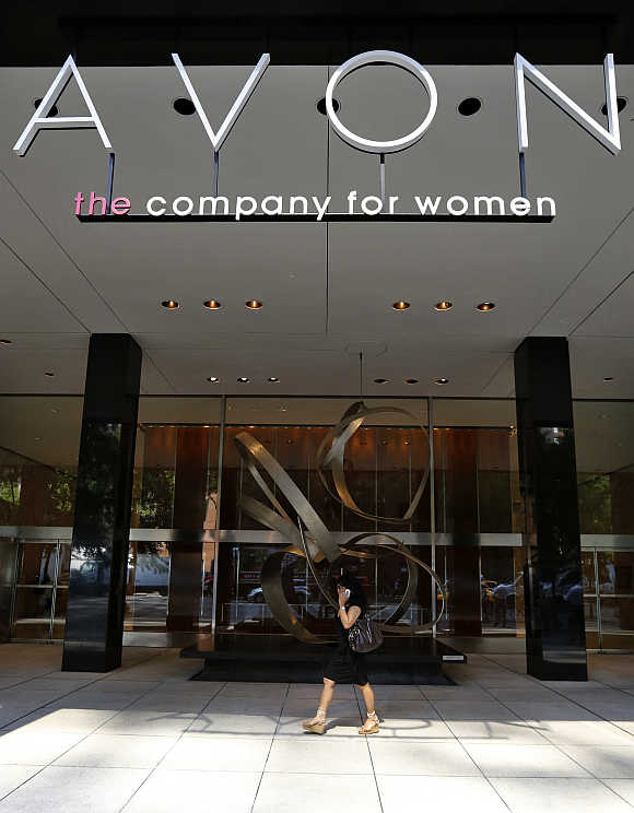 A woman walks in front of the Avon Products headquarters in midtown Manhattan area of New York.
