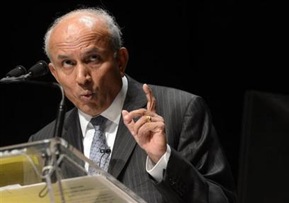 Fairfax Financial Holdings Ltd. Chairman and Chief Executive Officer Prem Watsa gestures while speaking during the company's annual meeting in Toronto