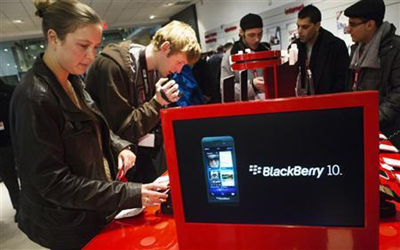 People view the new Blackberry Z10 device at a Rogers store in Toronto.