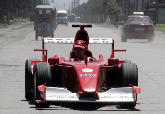 Zhao Xiuguo drives a homemade model of Formula One car in Tangshan, Hebei Province, some 180km (113 miles) east of Beijing.