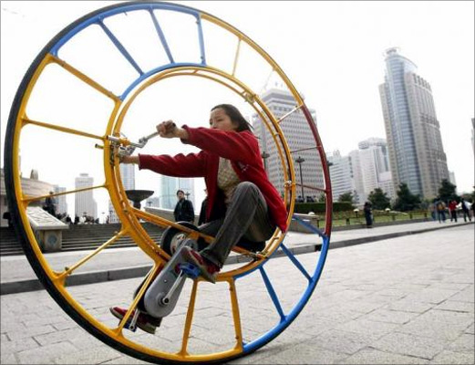 A woman rides an unicycle at a park in Shanghai.