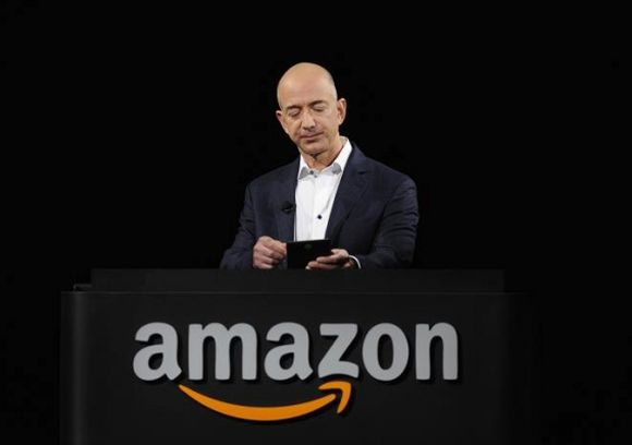 Amazon CEO Jeff Bezos demonstrates the Kindle Paperwhite during Amazon's Kindle Fire event.