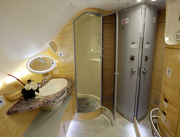 Bathroom with a shower stall for first-class passengers inside Emirates's Airbus A380.