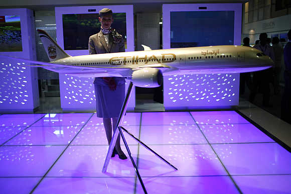 A model of an Etihad airline plane is displayed during the opening of the Arabian Travel Market show in Dubai.