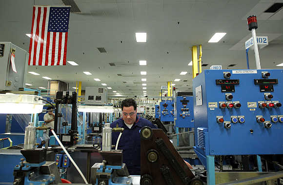 Mike DiBella monitors machines producing razor blades at Gillette's factory in Boston, Massachusetts.