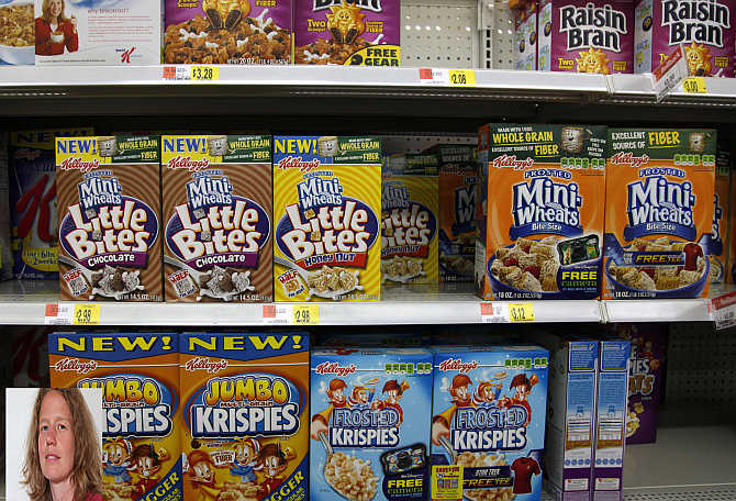Boxes of Kellogg's cereal are displayed on a store shelf in Westminster, Colorado. Inset, Amy Padour.