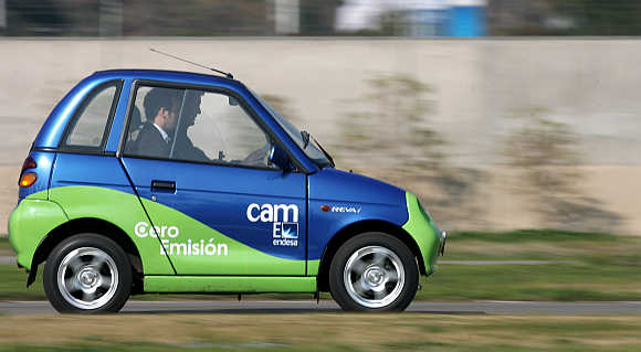 A man drives Reva Electric Car in Santiago, Chile.