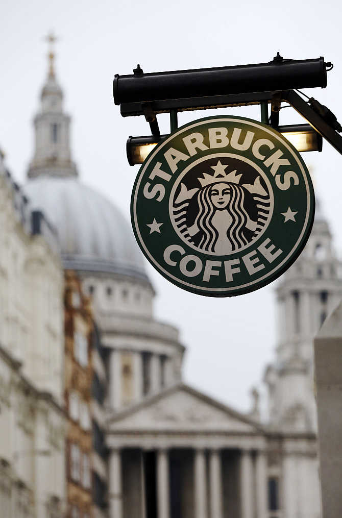 St Paul's Cathedral is pictured behind a signage for a Starbucks coffee shop in London.