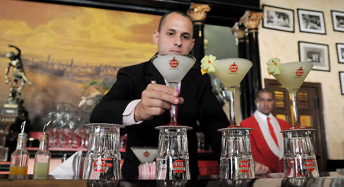 A bartender prepares a display of frozen daiquiris, a product of Pernod Ricard, at The Floridita bar in Havana, Cuba.