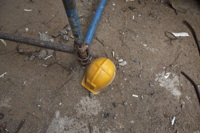 The helmet of a labourer lies at the construction site near Manesar.